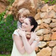 Mother giving son piggyback — Stock Photo #10314047