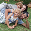 Cute family having fun together in a park — Stock Photo