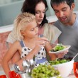 Cheerful family preparing food together — Stock Photo