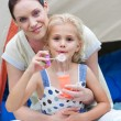 Mother and daughter having fun together in a park — Stock Photo #10314092