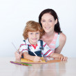 Stock Photo: Son and mother drawing looking at the camera