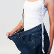 Close-up of woman wearing big jeans focus on woman — Stock Photo #10314159