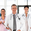 Senior Smiling doctor with his colleagues — Stock Photo #10314290