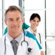 Stock Photo: Smiling doctor in row