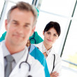 Stock Photo: Female doctor in row