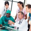 Medical team discussing in an office — Stock Photo #10314384