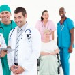 Stock Photo: Group of smiling doctors looking at the camera
