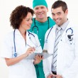 Team of relaxed doctors looking at the camera - Stock Photo