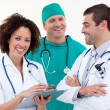 Group of attractive doctors looking at the camera — Stock Photo #10314455