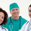 Group of attractive doctors looking at the camera - Stock Photo