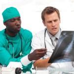 Two doctors examining an x-ray — Stock Photo #10314617
