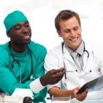 Two doctors examining an x-ray — Stock Photo #10314618