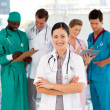 Attractive female doctor with her team - Stock Photo
