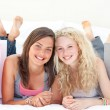 Portrait of two teen girls after shopping clothes — Stock Photo