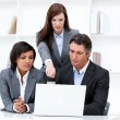 International business team working at a computer — Stock Photo