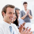 Smling business applauding good presentation — Stock Photo #10315646