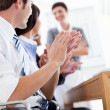 Jolly business applauding good presentation — Stock Photo #10315653