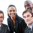 Multi-ethnic business smiling at the camera in a meeting — Stock Photo
