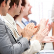 Portrait of a businessteam applauding during a meeting — Stock Photo