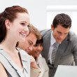 Stockfoto: Portrait of a smiling businesswoman working with her colleagues