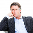 Attractive businessman looking at the camera against white backg — Stock Photo