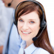 Portrait of caucasian businesswoman with headset on — Stock Photo #10316216
