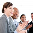 Portrait of smiling businessteam applauding presentation — Stock Photo #10316288