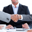 Close-up of a handshake between two businesspeople in front of t — Stock Photo