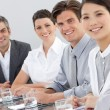 International business sitting around a conference table — Stock Photo