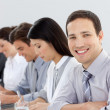 Young businessman in a meeting with his team — Stock Photo