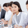 Bored asian businesswoman in a meeting — Stock Photo #10316385