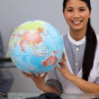 Assertive businesswomholding terrestrial globe — Stock Photo #10316497