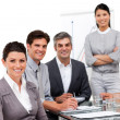 Stock Photo: Portrait of multi-cultural business team during presentation