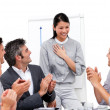 Victorious businesswoman applauded for her presentation - Stock Photo