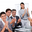 Stock Photo: Enthusiastic businessteam applauding after a presentation