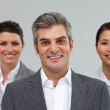 Smiling Business partners standing together — Stock Photo