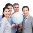 Portrait of a multi-ethnic businessteam holding a globe — Stock Photo