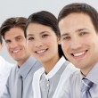 Foto Stock: Multi-ethnic business group smiling at camera