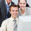 Smiling business working together with a computer — Stock Photo