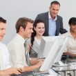 Multi-ethnic business and manager working with computers — Stock Photo