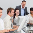Multi-ethnic business and manager working with computers — Stockfoto