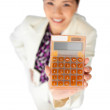 Smiling young businesswoman holding a calculator — Stock Photo