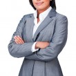 Portrait of a serious hispanic businesswoman with folded arms — Stock Photo