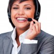 Young hispanic customer service agent with headset on — Stock Photo