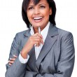 Laughing hispanic businesswoman holding a pen — Stock Photo