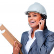 Female architect on phone bringing blueprints — Stock Photo #10316913