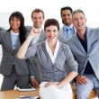 Succesful business team punching the air in celebration - Stock Photo