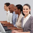 Stock Photo: International business in line working at computers