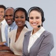 Young business with headset on smiling at the camera — Stock Photo #10316969