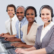 Multi-ethnic business with headset on in a call center — Foto de Stock